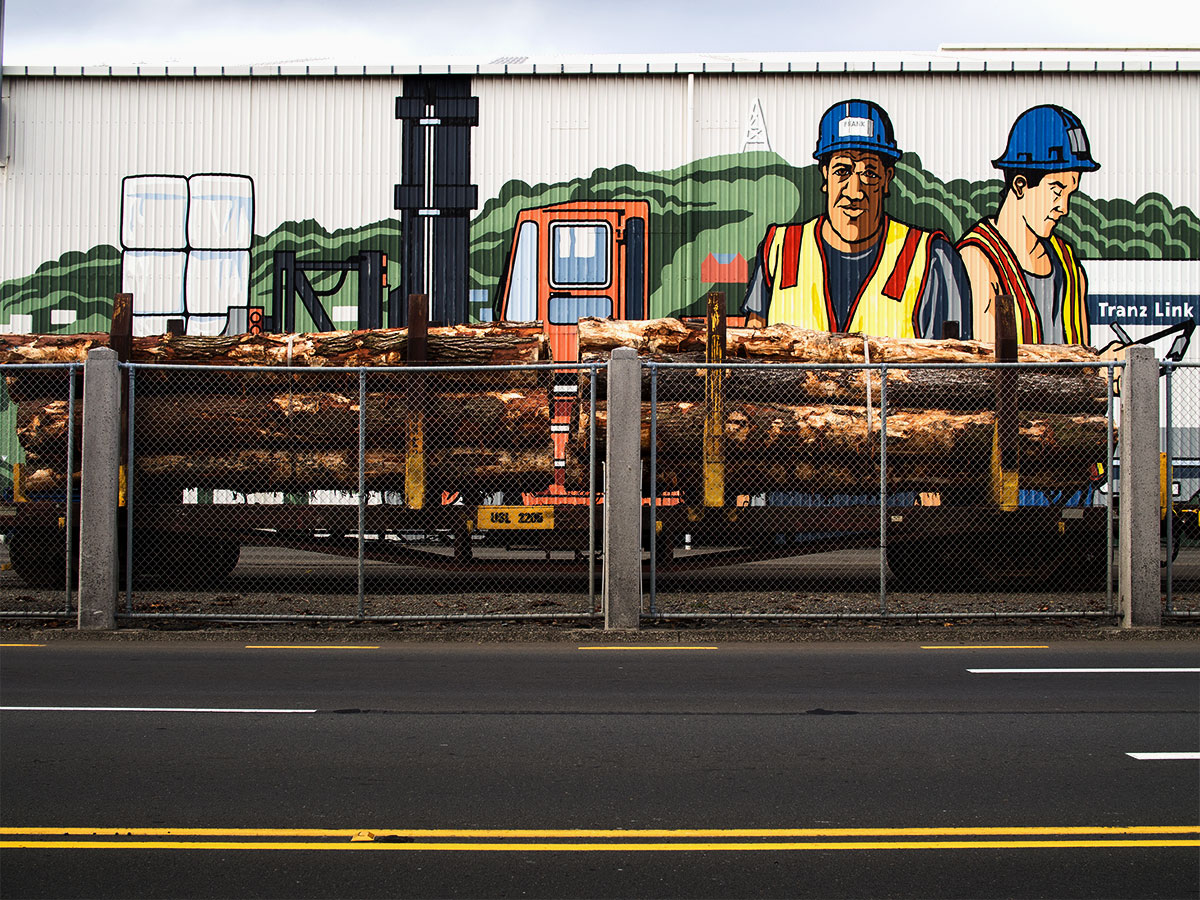 Artwork at the Wellington port with pieces of wood, trains and a fence New Zealand