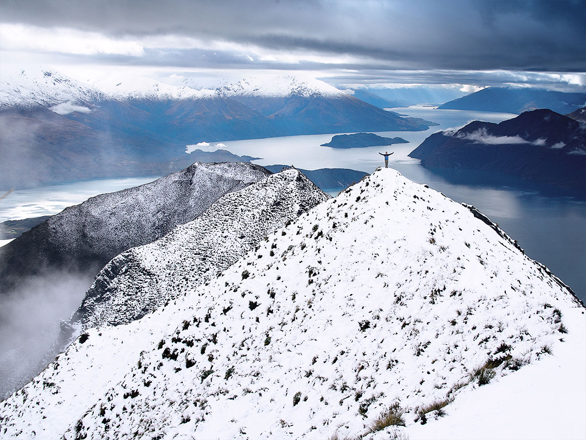 wanaka-roys-peak-winter-man-new-zealand